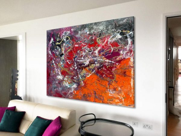 large orange and pink art above a sofa