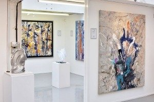 Contemporary paintings hanging in a gallery space