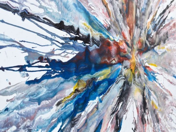 Blue paint on canvas like and explosion