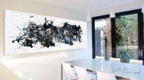 large black and white painting in a dining room