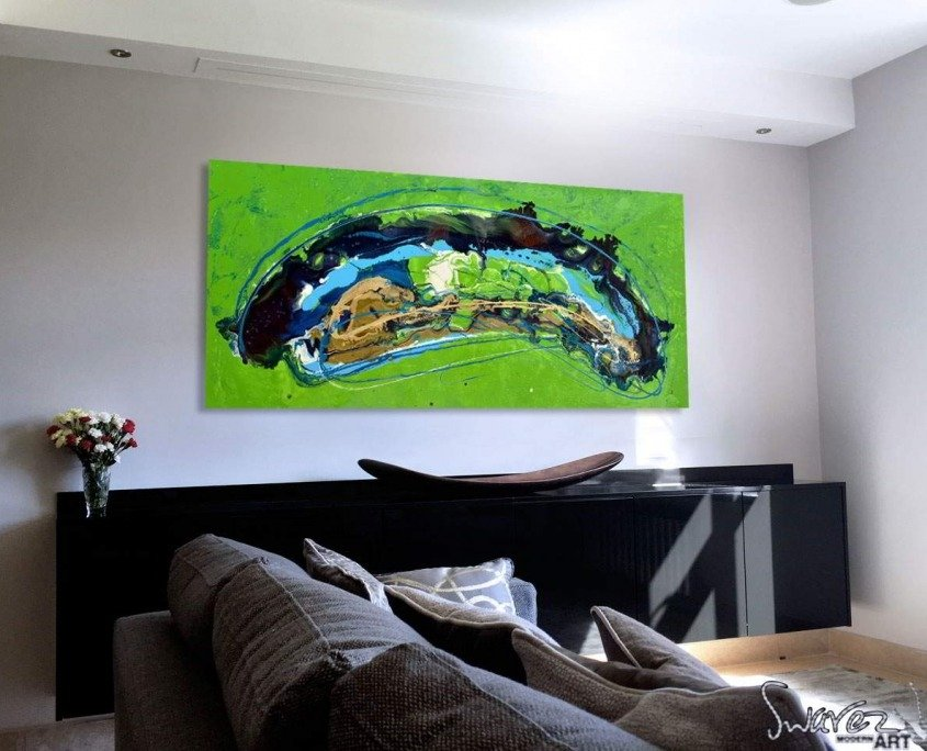 Blue and lime green art on a wall