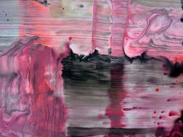 Swirl of pink and black paints on canvas