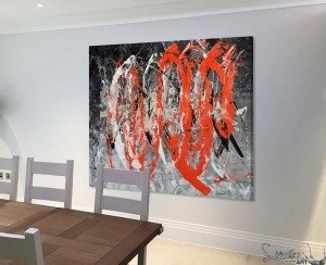 red black and white painting in a dining room by chairs