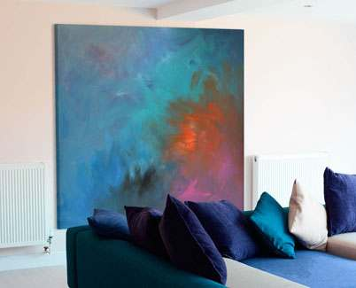 Square-aqua-and-orange-abstract-painting-in-a-living-room