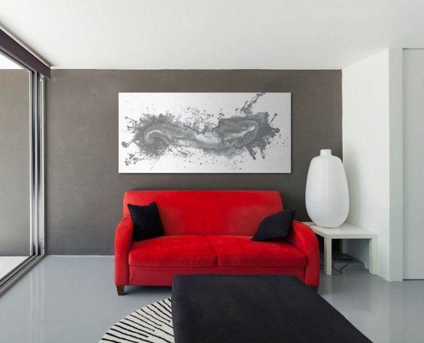 silver grey painting and red sofa