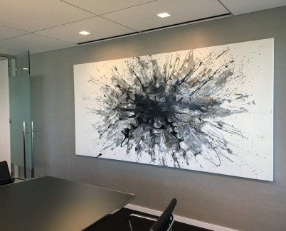 black and white modern art in corporate boardroom