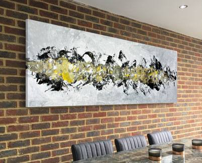 black and yellow painting on brick wall