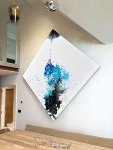 huge square painting on a wall