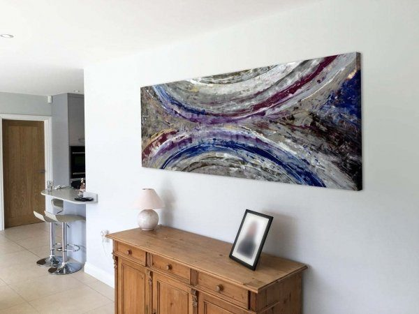 blue and silver abstract painting in living space