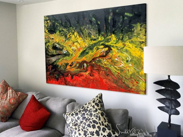Black orange and red painting on a wall above sofa