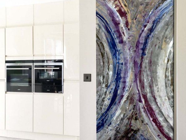 blue and silver art in kitchen