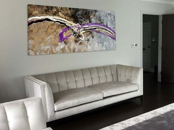 long purple and gold painting and sofa