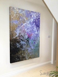 purple and black painting in hallway
