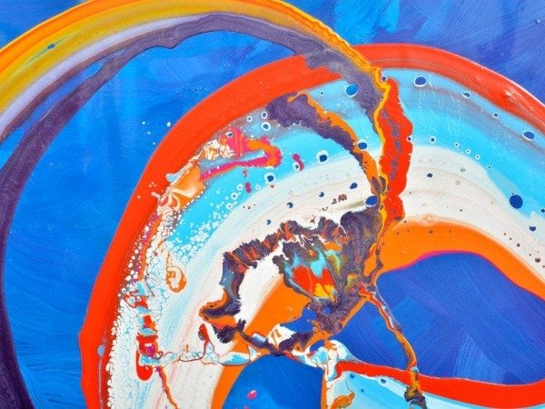 radial loops of paint on blue background
