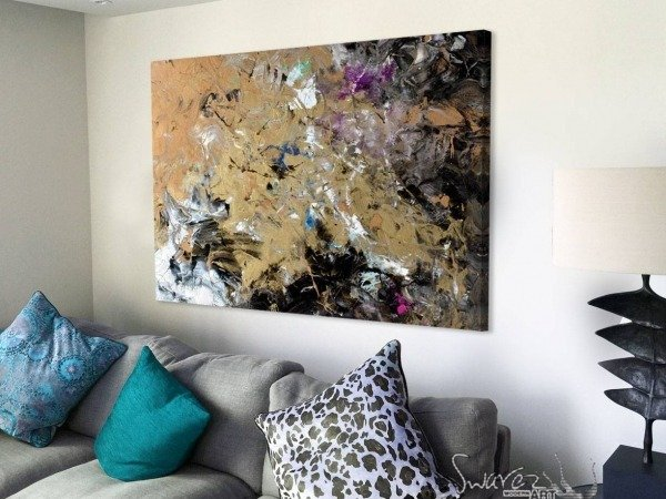 black and gold art on a wall