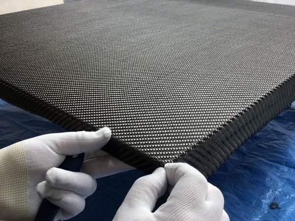 laying carbon fibre weave sheet