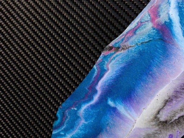 resin covered pigment on carbon fibre