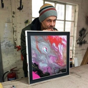 Swarez holding a painting