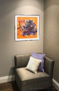 chair-with-orange-painting-hanging-above