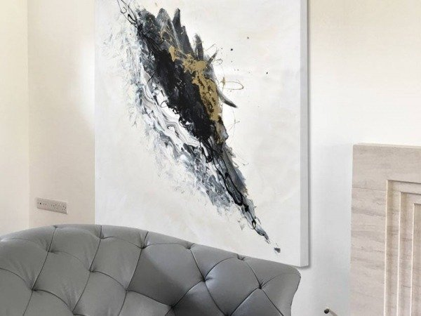 white and gold painting in living room