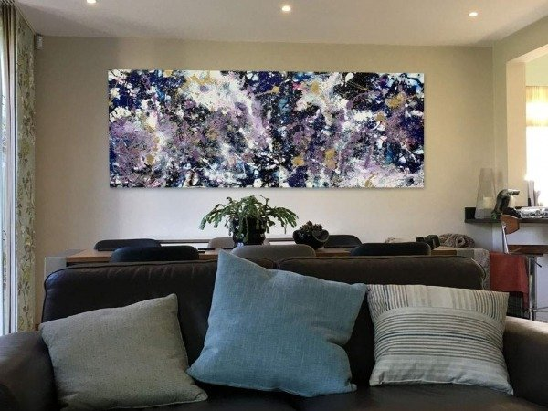 purple white abstract art above sofa