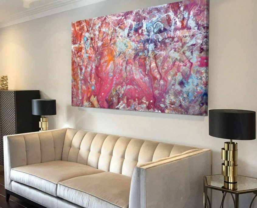 silver and red wall art above sofa