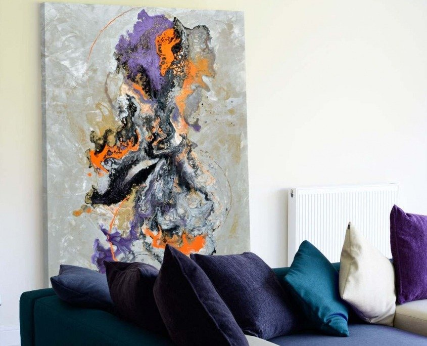 large abstract orange purple art with sofa