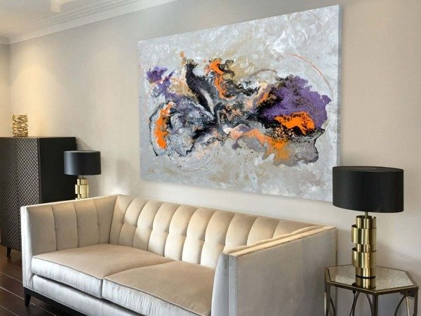 orange purple painting above sofa