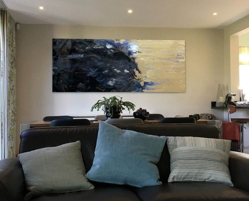 blue and gold abstract painting in dining room