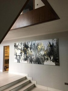large painting in hallway