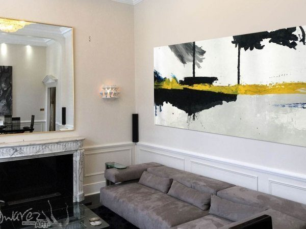 big yellow and black art in a house