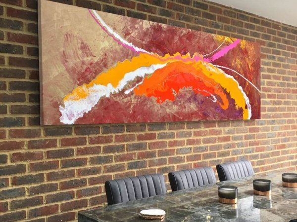 abstract painting with orange and pink paint