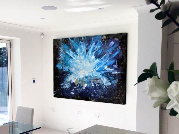 black and blue art in a kitchen