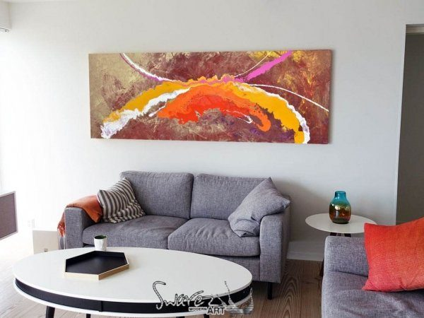 gold pink and orange modern art on a wall