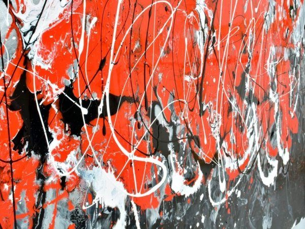 swirls of red and black paint