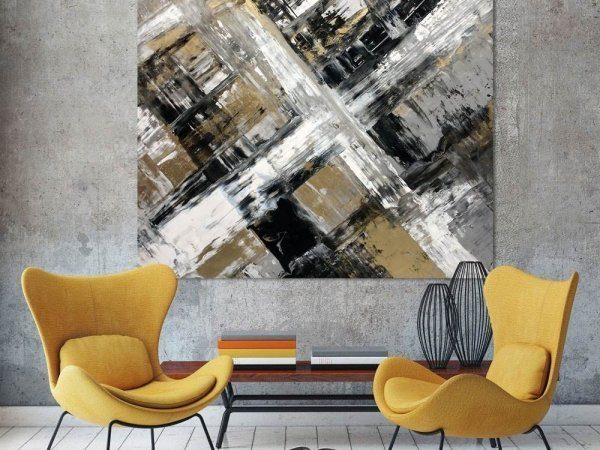 gold and black painting with two chairs