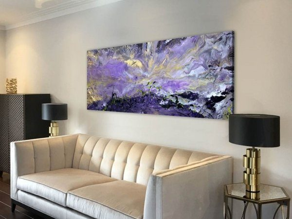 gold and purple art on a wall