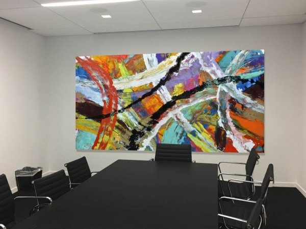 big colourful art in boardroom