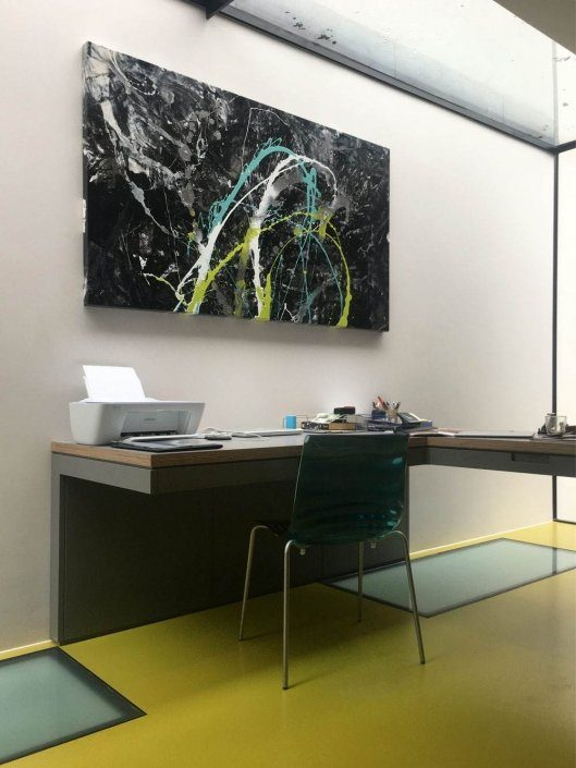 lime green and black art in office
