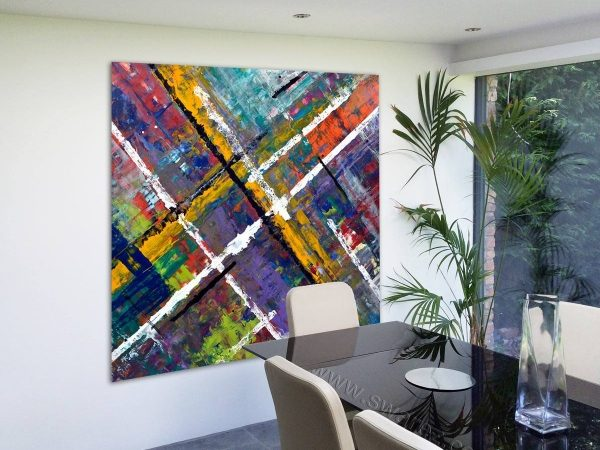 large square coloured art work in a dining room