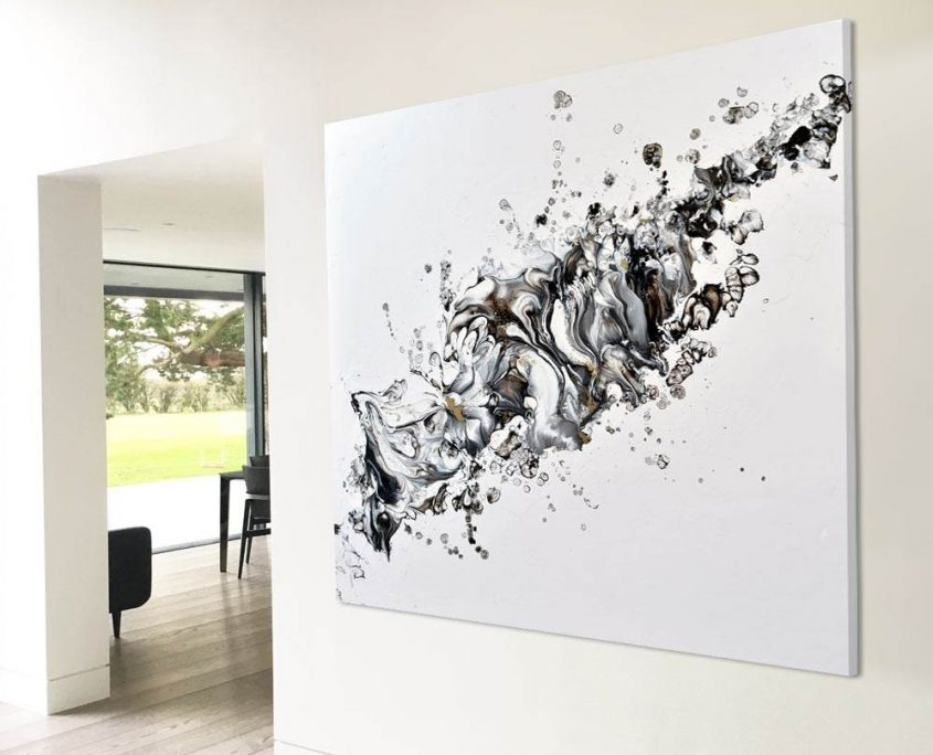 black and white abstract painting on a wall