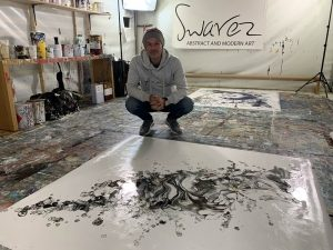 Swarez with a black and white abstract painting