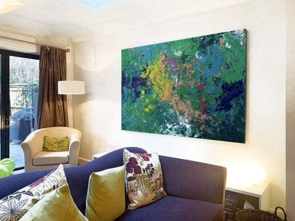 green abstract art in living room