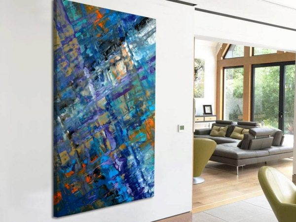 blue abstract painting hung on a wall
