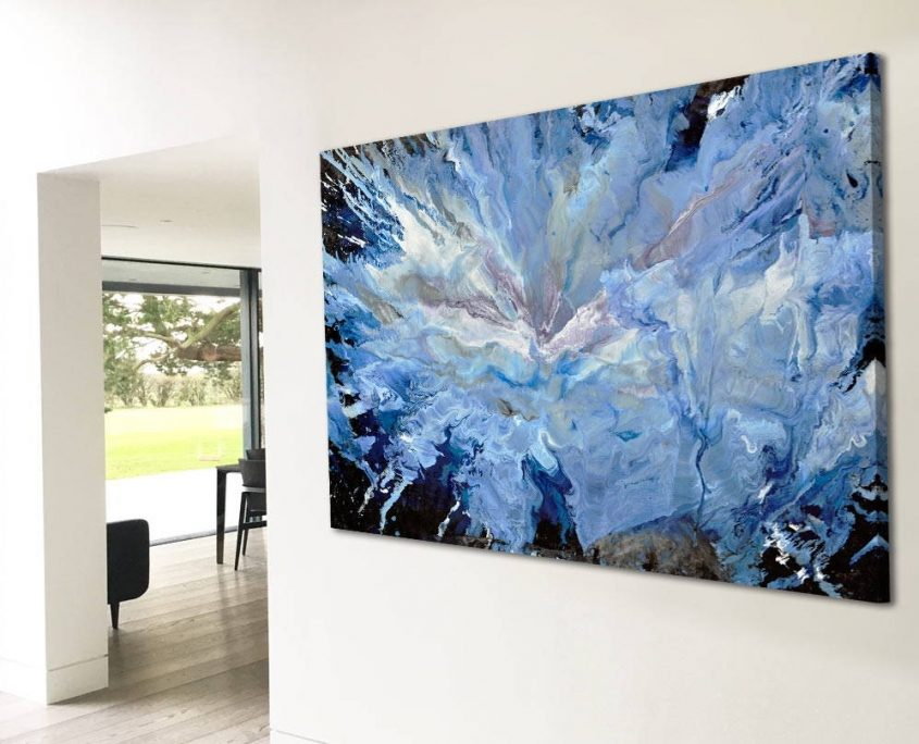 large blue and white painting on a wall