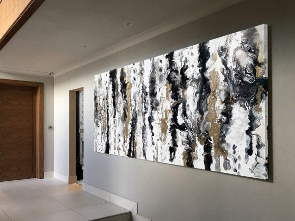 large black and white art in hallway