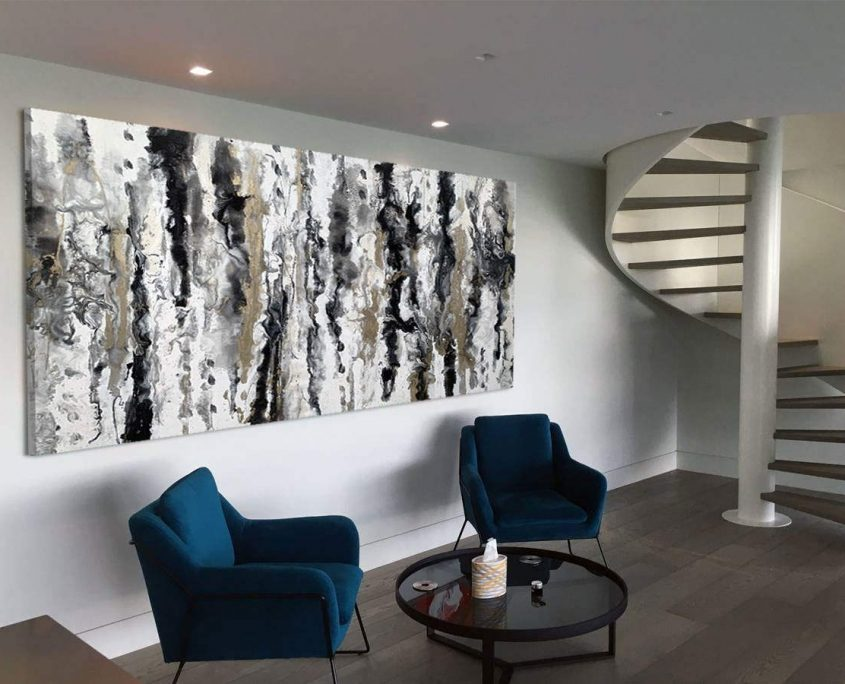 large-black-white-and-gold-painting-on-a-large-white-wall