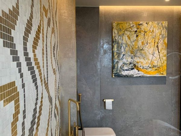 grey and yellow art in a bathroom