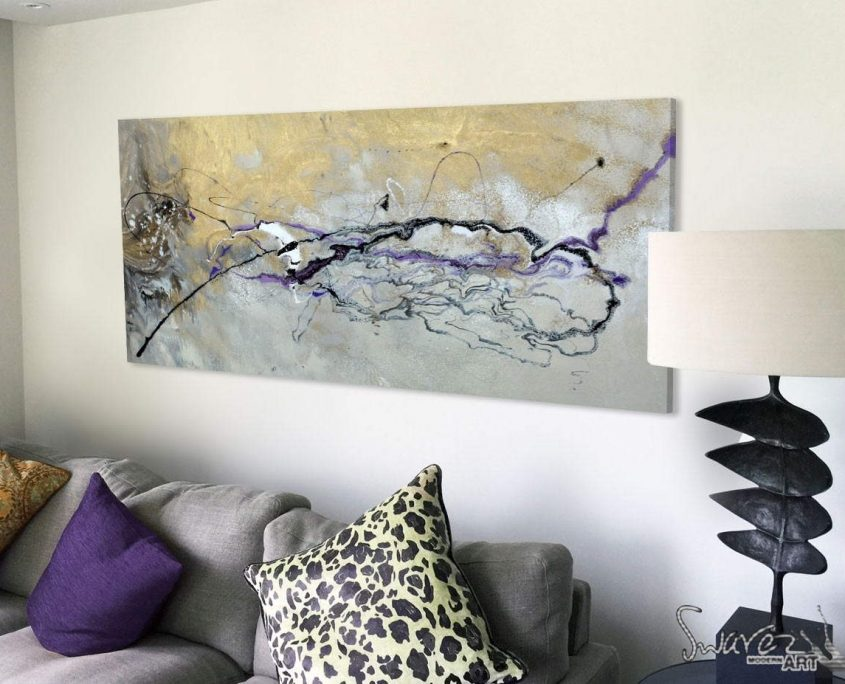 gold and purple abstract painting above sofa