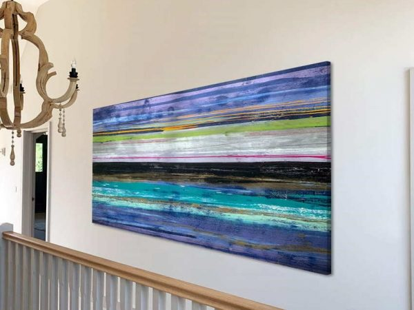 grand stairwell with abstract art hanging